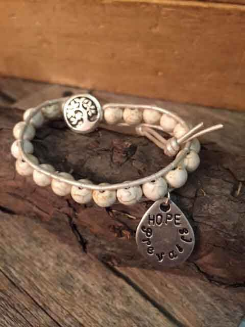 leather-beaded-bracelet-with-teardrop-hope-prevails-charm-cream-leather-cream-beads