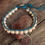 leather-beaded-bracelet-with-teardrop-hope-prevails-charm-turquoise-leather-cream-beads-2