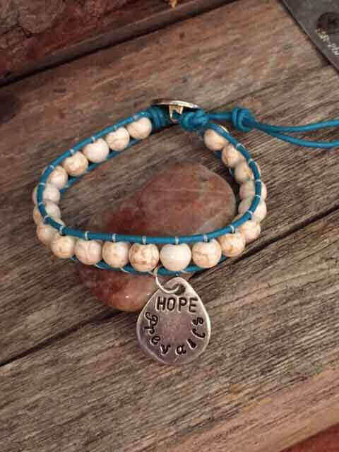 leather-beaded-bracelet-with-teardrop-hope-prevails-charm-turquoise-leather-cream-beads