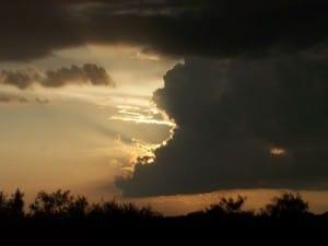 sun behind clouds dramatic