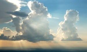 sun behind white clouds