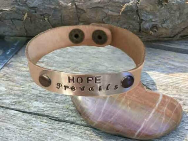 Leather cuff bracelet with hand stamped Hope Prevails brown leather