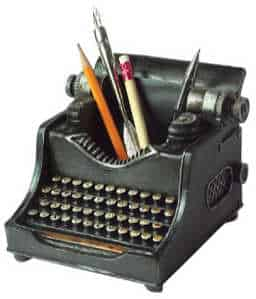 A pencil cup shaped like a typewriter for all the pencils, pens and highlighters a writer hoardes.