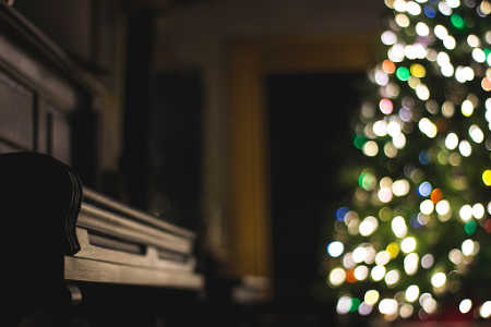Keep peace at Christmas by focusing on time together on activities like singing carols.